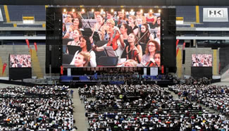 7,548 musicians gathered in a football stadium in Frankfurt to play for 45 minutes, conducted by Wolf Kerschek.