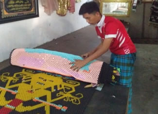 Mr. Ab Majid Ab Rahman from PMC Pahang, Cherating, Pahang, has made an 17.8-m long (and 1 m width) beaded art, tied each other by strings with variety of colours and motives, which sets the new world record for the Longest beaded Art, according to the World Record Academy.
