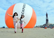 Measuring a staggering 18m in diameter, the orange and white beach ball was custom-made, weighing in at 400kg - about the same as an adult horse.