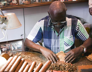 Record-setting Cuban cigar roller Jose Castelar has broken his own world record, rolling a cigar that measures nearly 100 metres.