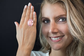 The 59.60-carat pink diamond Pink Star diamond has become the world's most expensive gemstone, selling at auction for $71.2 million (£57.3 million) including buyer's premium