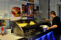 Photo: Vernaillen has spent 125hrs frying chips during the World's Longest French Fries cooking marathon.