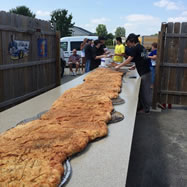 MIDDLEBURY, IN, USA -- Employees and supporters of the Rulli's Italian Restaurant in Middlebury successfully baked a nine foot long, 22 inch wide, 70 pound calzone - breaking the previous Guinness World Records' record, as part of a fundraiser for the Middlebury Boys and Girls Club, according to the World Record Academy: http://www.worldrecordacademy.com/.