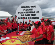 Hungry Lion set a new World Record for the largest serving of fried chicken ever. To celebrate Heritage Day, over 1.6 tonnes (1,631.216kg) of free chicken was served to Mitchells Plain residents.