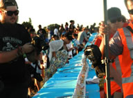 Hundreds of people gathered at Manurewa's Mountfort Park to take on the Guinness World Record for the longest icecream. More than 600 participants beat past efforts by scooping a giant 596.5-metre sundae.