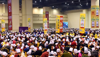 With winter solstice, one of 24 Chinese traditional astronomical markers, around the corner, nearly 7000 people have begun making dumplings together at Zhengzhou's International Exhibition Center, hoping to set a new World Record for the largest cooking lesson in Henan's capital, Zhengzhou. Families, including adults and their children, ranging in age from 4 to 70 years old, take part in the event.