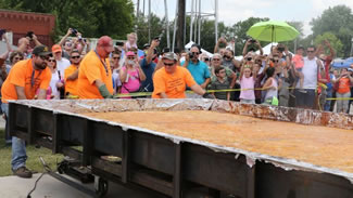 The cobbler weighed 2,902 pounds, breaking the previous Guinness world record of 2,251 pounds set by Ruston, La.