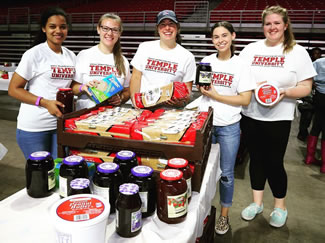 The school has set the world record for the most peanut butter and jelly sandwiches made in one hour, as hundreds of volunteers put together 49,100 sandwiches at the Liacouras Center.