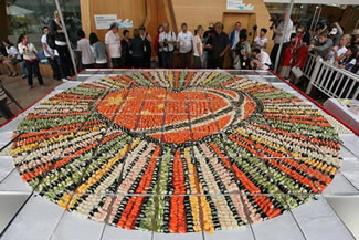 A new World Record has been set in Norway for the largest sushi mosaic - measuring an incredible 56.50 square metres and including a whopping 800 kg of salmon and 400 kg of rice. About 200 litre of rice vinegar, 480 kilogrammes of cucumber and 10 kg chives were also used in the attempt.