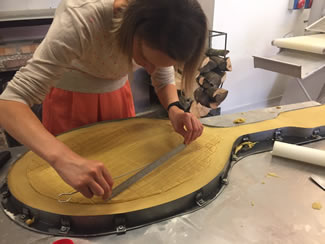 Great British Bake Off winner Frances Quinn has created the world's biggest Jammie Dodger style biscuit. The master baker from Market Harborough teamed up with Hambleton Bakery, from Exton, Rutland, to produce the 4ft 2 inches (127cm) long monster which weighed in at 26.76 kg.