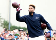New York Giants' Odell Beckham Jr. catches a pass from New Orleans Saints' Drew Brees, while setting the World Record for the most one-handed catches in one minute with 33 on Thursday, Jan. 29, 2015 in Scottsdale, Ariz.