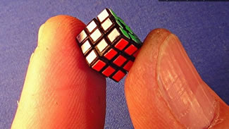 Tony Fisher, who holds the Guinness World Record for largest Rubik's cube after building a puzzle measuring more than 5 feet tall, created a Rubik's cube measuring only .22 inches on each side.