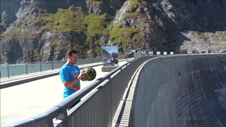An Australian trio has broken the world record for the highest basketball shot, launching the ball from the top of a dam in Switzerland. It took the group, consisting of Brett Stanford, Derek Herron and Scott Gaunson, three attempts to make the shot.