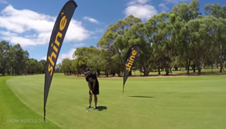 Brett Stanford had to take a three-quarter length swing in order to hit the ball far enough to find the bottom of the cup and all the action was caught on camera.