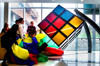 A giant Rubik's Cube newly installed on the University of Michigan's North Campus is the world's largest hand-solvable, stationary version of the famous puzzle. The 1,500-pound, mostly aluminum apparatus was unveiled on the southwest corner of the second floor of the G.G. Brown Building. It was imagined, designed and built by two teams of mechanical engineering undergraduate students over the course of three years.