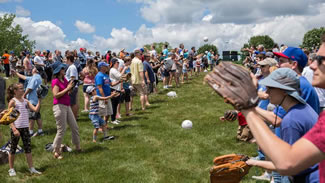 In north suburban South Barrington, 972 pairs of people tossed a ball back and forth at Willow Creek Community Church.