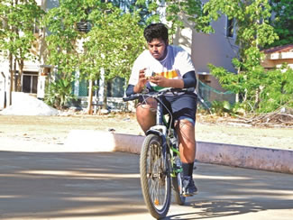 P.K. Arumugam, from Chennai, has smashed the Guinness World record for solving Rubik's Cubes while cycling by managing 1,010 of the mind-bending puzzles while on two wheels; he cycled for six hours and seven minutes last weekend to beat the standing record of 751 cubes solved in seven hours, two minutes.