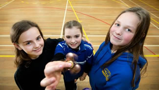 Penny Hambling, Tessa Georgeson and Jade Hassall, all 12, with their fidget spinners following Bell Block Primary School student council's attempt to set a world record for the most people spinning the gadgets in one place for 30 seconds.