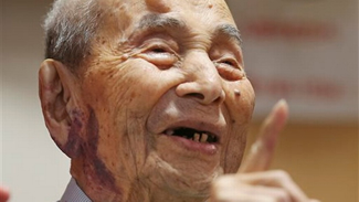 Yasutaro Koide, the 112-year-old living in central Japan's Nagoya, smiles upon being formally recognized as the world's oldest man at a nursing home in Nagoya. Koide was born on March 13, 1903.
