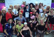 "Sporting the many looks of Madonna, organizers of the 19th annual Fool's Paradise Drag Party in Fire Island Pines pose with an adjudicator from Guinness World Records on Saturday, Aug. 30, 2014, after setting the record for ""Largest Gathering of People Dressed as Madonna."" Photo Credit: The Fool's Paradise Drag Party."