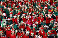 "As many as 1,792 of Santa's little helpers, aged between nine and 15, donned red, green and white hats, matching T-shirts and pointy plastic elf ears, clustered into the shape of the word ""Siam"", the former name of the Southeast Asian country, as they broke the Guinness World Recods world record for the largest gathering of Christmas elves, according to the World Record Academy: www.worldrecordacademy.com/."