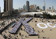 The largest human letter consists of 910 participants and was achieved by KOC company (Kuwait) in Kuwait City, Kuwait. The participants formed the letter K.