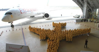Ethiopian Airlines has broken a Guinness World Record for making the largest ever human image of an Airplane. The event was part of Africa's first Airbus A350 XWB delivery and 350 Ethiopian Employees have gathered at Ethiopian Maintenance hangar to create an image of the actual A350 aircraft.