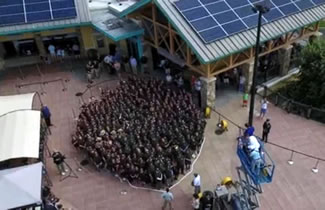 It took 323 people to create the world's largest human image of an arrowhead outside Ripley's Aquarium of the Smokies.