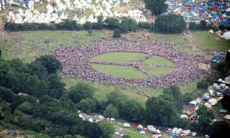 About 15,000 people gathered at Glastonbury's monumental stone circle to set a new world record for making the world's biggest human peace sign.