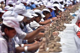 A total of 3,082 children from 160 schools in the Pune Municipal Corporation limits were part of the biggest workshop held in Pune; they made 3,082 Ganesha Idols, thus setting the new world record for the Most students making Ganesha Idols in one place, according to the World Record Academy.
