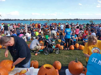Citizens from across metro Detroit gathered in Nautical Mile Park on Water Street for a Pumpkin Palooza Party hosted by the Mariner Theatre, the Marine City Area Chamber of Commerce and Vandenbossche Farms.The group carved 1,064 pumpkins, topping the previous record by four.