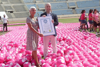 World Health Oorganization's Representative in Lebanon Dr. Gabriele Reidner and Minister holding the certificate proudly and standing inside the ribbon.