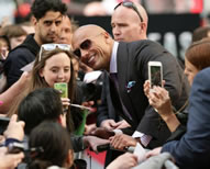 - Dwayne Johnson, aka The Rock, smashed the selfie Guinness World Records world record; the 43-year-old star took to the red carpet in London's Leicester Square with co-stars Kylie Minogue, Alexandra Daddario and Carla Gugino and director Brad Peyton; before the screening of the disaster drama, the Fast And Furious actor posed for selfies with 105 fans, setting the new world record for the Most selfies taken in three minutes.