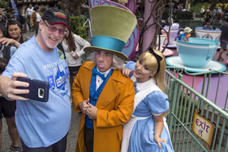 Huntington Beach resident Jeff Reitz, who has visited the parks of the Disneyland Resort every day since January 1, 2012, marked his 2,000th consecutive visit on June 22. Here, Reitz snaps a selfie with The Mad Hatter and Alice after a teacup ride at the Mad Tea Party in Fantasyland at Disneyland during his 2,000th visit to the park.