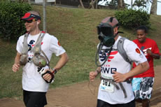 fastest marathon wearing a gas mask Staff Sgt. Marc Dibernardo