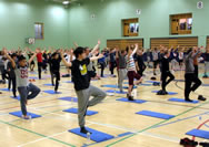 A total of 110 men took part in the all-male class led by Dave Smythe at the National Sports Centre in Douglas, which sets the new world record for the Largest male yoga class, according to the World Record Academy; the event was the brainchild of Kate Bergquist, health and well-being co-ordinator at Isle of Man College, who was keen to mark International Men's Day.