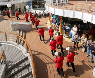 Musicians from the British Imperial Military Band completed multiple laps of a specially-measured circuit of the giant cruise ship's pool deck, completing the one-mile march in an impressive 14 minutes 26 seconds.