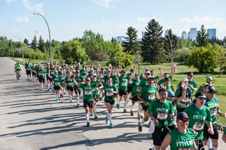 A total of 112 linked runners crossed the finish line together at the Calgary Marathon, breaking the Guinness World Record for the