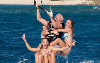 Founder of the Virgin Group, Richard Branson and Alice Galliers (both UK), Susi Mai (Germany) and Alison DiSpaltro (USA) had set the World Record for most people riding a kitesurf board at the age of of 63.