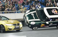 "A driver in a BMW M4 Coupe has claimed a new World Record for completing the ""most donuts around a car driving on two wheels in one minute."" The record breaking attempt was completed earlier this month in Chongqing, China when Zhang Shengjun managed to complete ten donuts around a MINI Cooper being driven on two wheels by Han Yue."