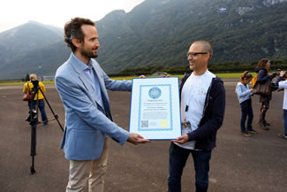 On behalf of the World Record Academy, the world's largest certifying organization, the new world record was verified & certified 'on-the-spot' by Mr. Cattaneo Gianni (left), a Lugano-based attorney-at-law at