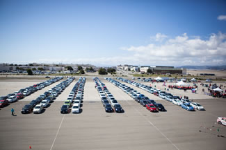 Toyota owners, a total of 332 made a parade lap to celebrate the Earth Day on April 22, 2016. The Toyota Prius is a full hybrid electric mid-size hatchback car and is considered to be the cleanest vehicles sold in the United States.