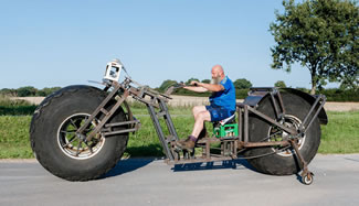 Frank Dose constructed world's heaviest rideable bicycle from scrap steel, and fitted it with giant, 5-foot diameter tires that once belonged to an industrial fertilizer spreader.