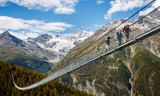The Charles Kuonen Suspension Bridge, in the Swiss Alps, near the village of Randa, is a record-breaking 494 metres long and connects Grächen and Zermatt on the Europaweg foot trail.