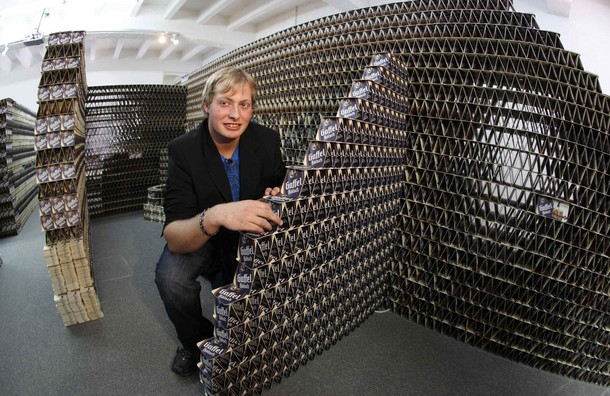 Largest house made of beer coasters world record set by for Biggest home bathroom in the world