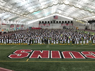 A total of 972 Youngstown State University students, alumni and community members gathered on the school's campus in their best penguin finery to celebrate the school's 50th anniversary as a university and to set the new world record for the Largest gathering of people dressed as penguins, according to the World Record Academy.